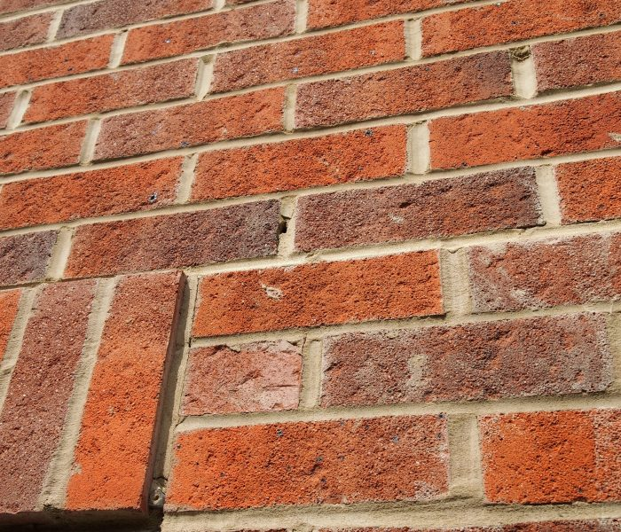 Mortar smeared brickwork, misaligned mortar perps & open mortar joints