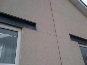 Movement in steel lintels not accounted for and subsequent cracking to render