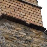 Erosion to limestone parapet copings