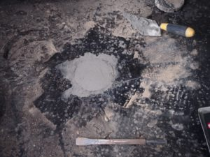 Cored hole made good prior to refitting carpets.