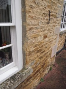 Newly applied OPC mortar fillets to window frames cracked within days of being applied. Note complete absence of sealant.