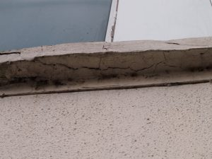 Cracked concrete due to corroded embedded steel