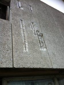Precast panel having rebar descaled ready for concrete repairs.