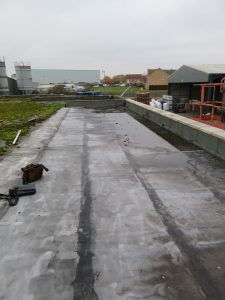 New section of flat roofing with heavy water ponding due to poor falls